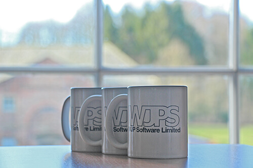 WJPS Mugs on table